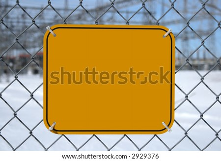 Blank high voltage danger sign with copy space at the chain link fence of a power station. - stock photo