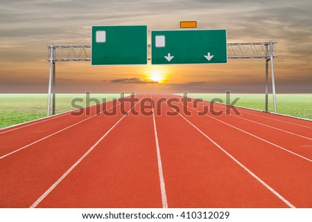 Blank highway and road sign with Running track  green grass and  sky sunset - stock photo