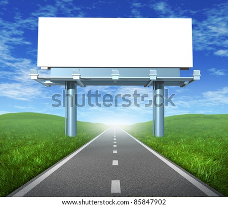 Blank  highway billboard sign in an outdoor display showing a road representing the concept of focused advertising and marketing communications to clients and consumers to promote and sell a brand. - stock photo