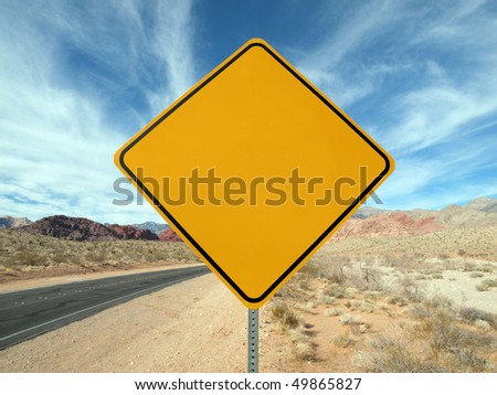Blank highway sign crossing the Nevada desert. - stock photo