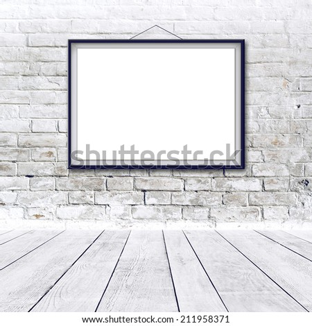 Blank horizontal painting poster in black frame hanging on white brick wall. Painting proportions match international paper size A. - stock photo