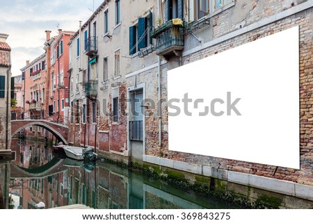 Blank horizontally oriented billboard with copy space on the wall in Venice, Italy  - stock photo
