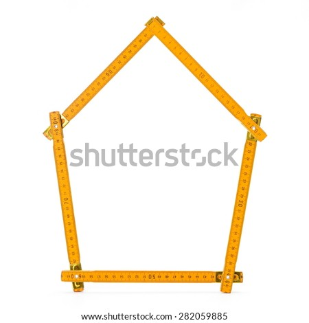 Blank house contour folded from meter ruler - stock photo