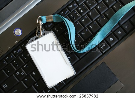 Blank ID card / badge on laptop /notebook - stock photo