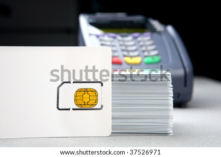 blank id card with chip and pos terminal in the background - stock photo