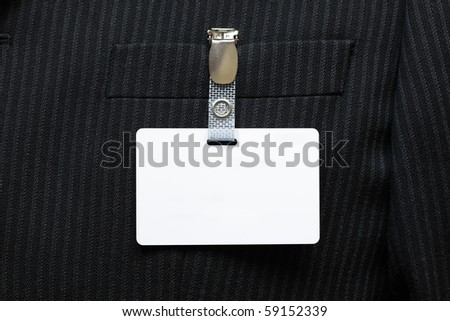 Blank identity tag hanging from a businessmans suit - stock photo
