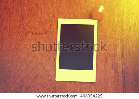 Blank instant photo and clippaper hanging on the wood.Designer concept.Vintage or retro tone. - stock photo