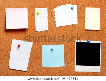 Blank instant photo and note papers on a cork board - stock photo