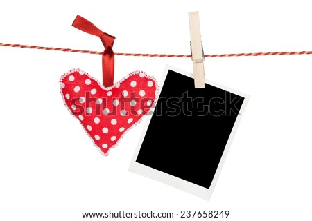 Blank instant photo and red heart hanging. Isolated on white background - stock photo