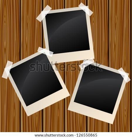 Blank instant photo frames on a wooden wall. Raster version. Vector is also available in my gallery - stock photo