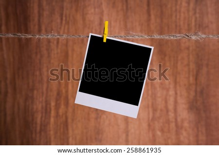 Blank instant photo hanging on the clothesline - stock photo