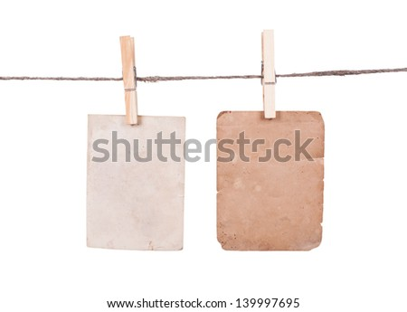 Blank instant photo hanging on the clothesline. Isolated on white background - stock photo