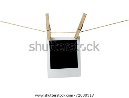 Blank instant photo hanging on the clothesline. Isolated on white background. - stock photo
