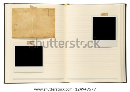 Blank instant photos, old postcard in notebook - stock photo
