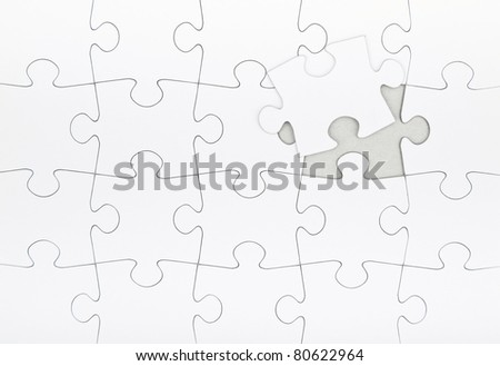 Blank jigsaw puzzle final piece coming in place. Business metaphor insert your own image