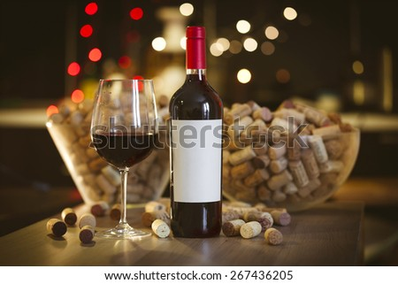 Blank label bottle of red wine with a glass - stock photo