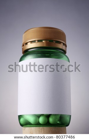 blank label for the text on green bottle - stock photo