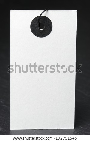 Blank label with twine on a black slate - stock photo