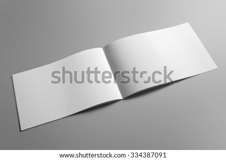 Blank landscape brochure magazine isolated on cardboard background, with clipping path, changeable background  - stock photo
