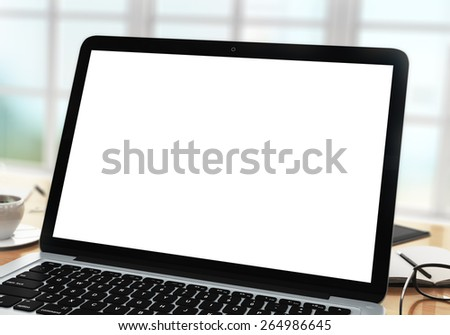 blank laptop on table in office, close up - stock photo