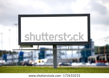 Blank Large billboard against blurred shopping center for your advertisement - stock photo
