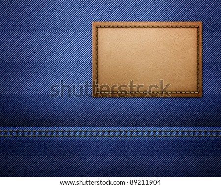 Blank leather jeans label on a blue jeans - stock photo