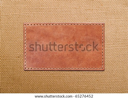 blank leather label stitched onto the canvas - stock photo