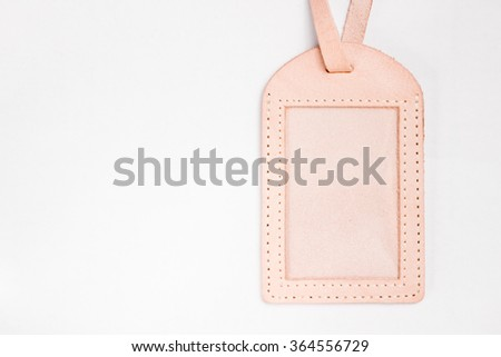 Blank leather luggage tag on white background - stock photo