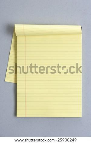 Blank legal pad on a modern grey desk - stock photo