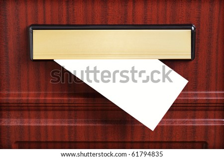 Blank letter coming through the letterbox ready to add your own message - stock photo