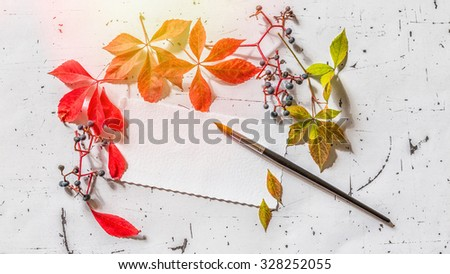 Blank letter with dry autumn leaves, vintage style - stock photo