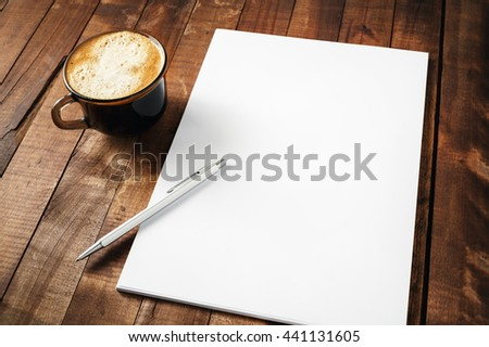 Blank letterhead, coffee cup and pen on vintage wooden table background. Blank branding template. Photo of blank stationery. Mock-up for design portfolios. - stock photo