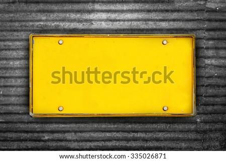 blank license plate on black rusty galvanized iron - stock photo
