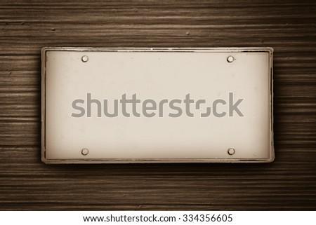 blank license plate on grey fiber glass ,vintage tone - stock photo