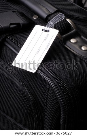 Blank Luggage Label On A Black Suitcase - stock photo