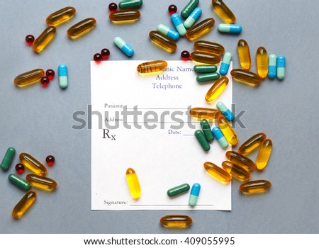 blank medical prescription and pills on gray background isolated - stock photo