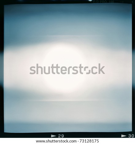 Blank medium format (6x6) color film frame with abstract filling containing light leak in center, kind of a background - stock photo