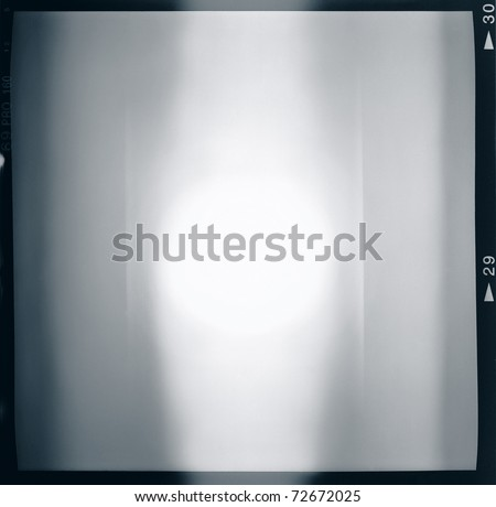 Blank medium format (6x6) film frame with abstract monochrome filling, containing lightleak in the center - stock photo