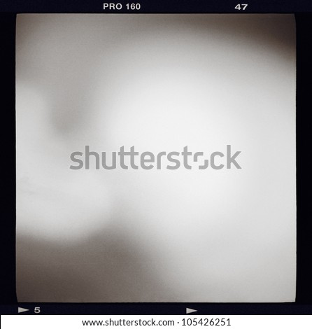 Blank medium format 6x6 monochrome black and white film frame with abstract filling containing