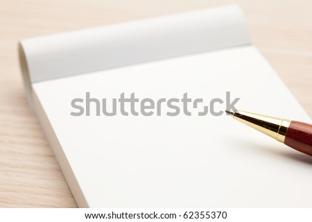 Blank memo pad isolated on white.
