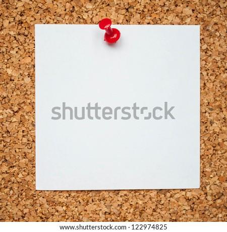 Blank memo paper on cork board - stock photo