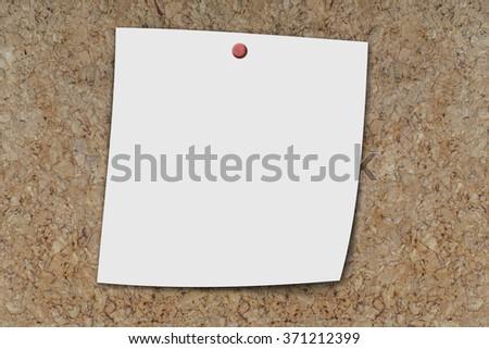 blank memo sheet pinned on a cork board  - stock photo