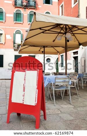 Blank menu board at street cafe - stock photo