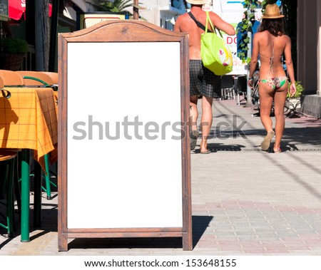 Blank menu board on the street. Selective focus on the blank board - stock photo