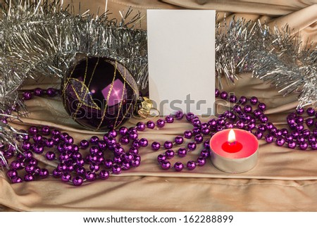 Blank message card with ornaments and candle - stock photo