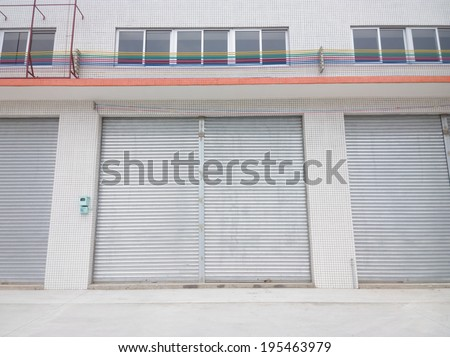 blank metal shutter doors on commercial shop front