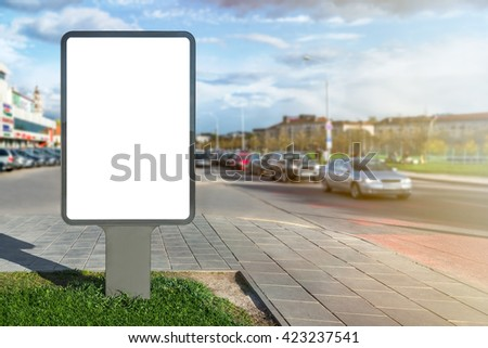 Blank mock up of vertical street advertising billboard on city background - stock photo