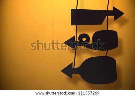 Blank modern hanging sign with space text on orange cement wall - stock photo