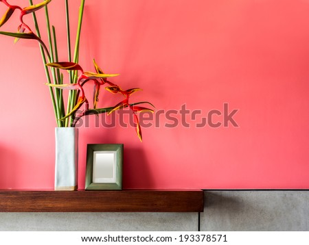Blank modern interior wall with flowers in ceramic vase - stock photo