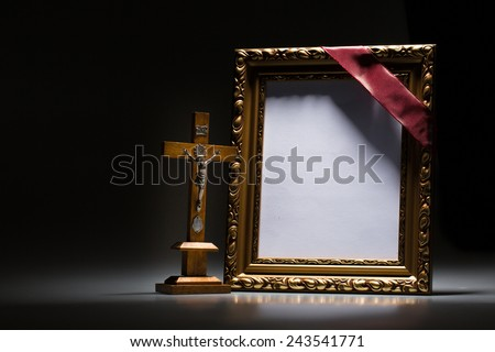 Blank mourning frame for condolence card on dark background - stock photo